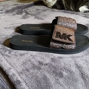 Michael Kors size 6 sliders.  Never worn.